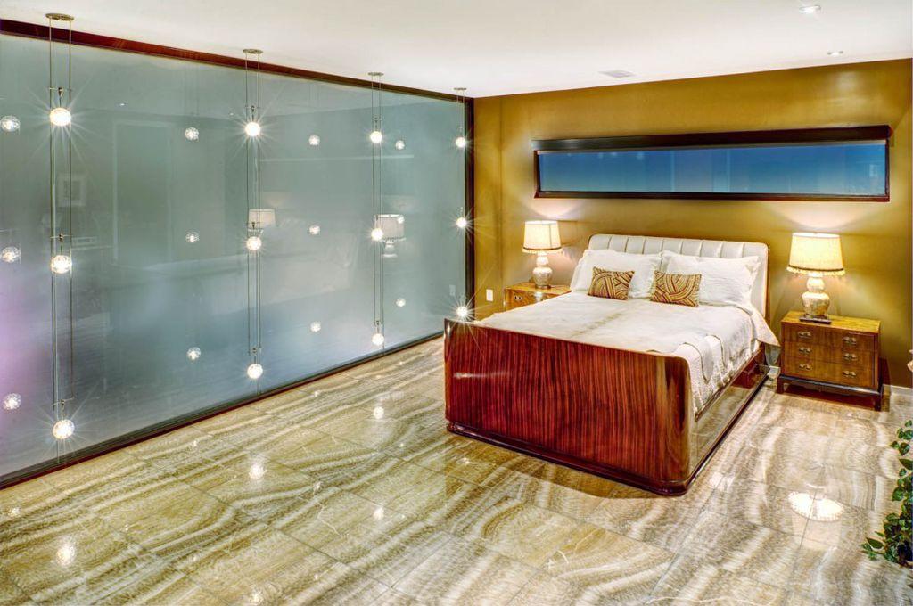 Modern Master Bedroom with Built-in bookshelf, complex marble tile floors, Wall sconce, stone tile floors, Standard height