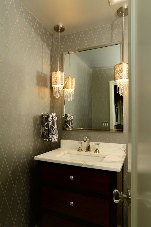 Modern Powder Room with Complex marble counters, Pendant light, Standard height, specialty door, Flat panel cabinets