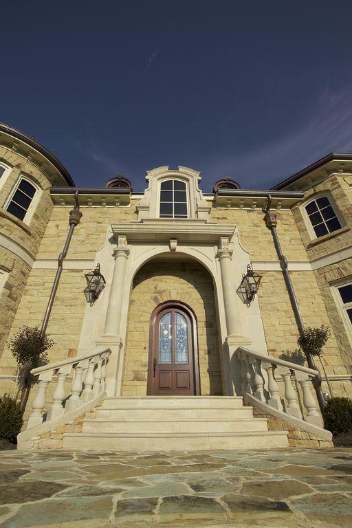 Traditional Front Door with Glass panel door, Pathway, exterior stone floors, specialty window, Deck Railing