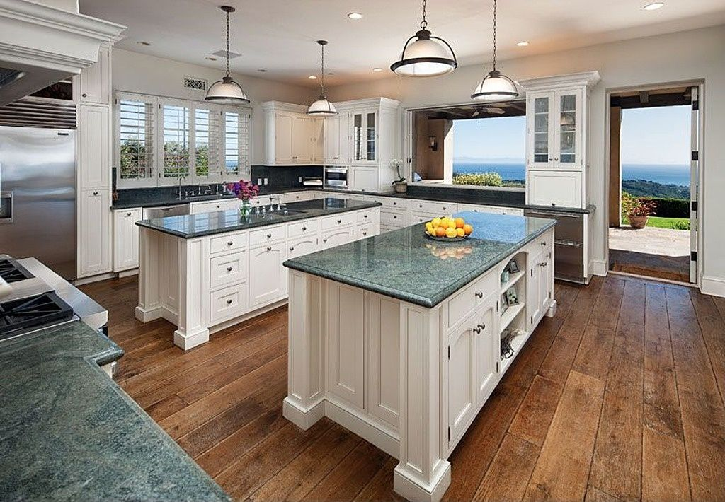 Traditional Kitchen with can lights, Custom hood, Casement, gas range, Glass panel, Simple Granite, Standard height, U-shaped
