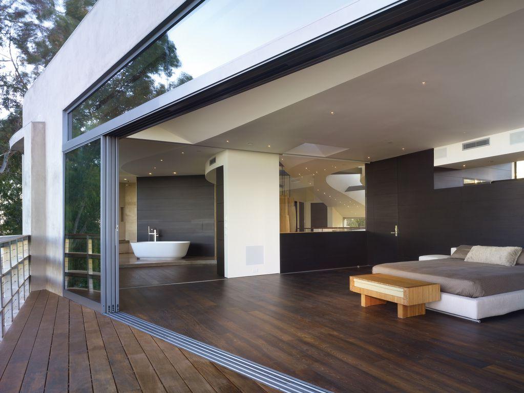 Contemporary Master Bedroom with Standard height, Nana wall system, Multi track sliding doors, Paint, Platform bed, flat door
