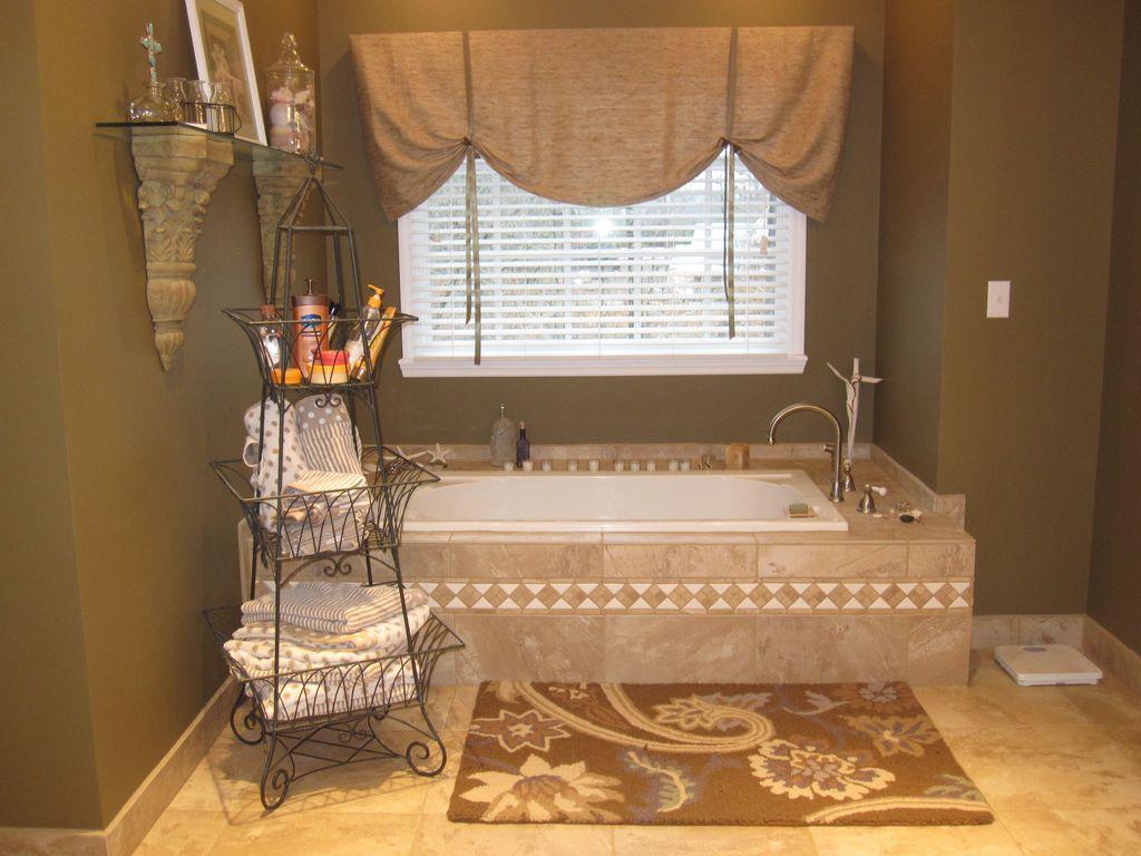 Country Master Bathroom with High ceiling, Kohler - Tea Two Drop-In Bath, limestone tile floors, Master bathroom