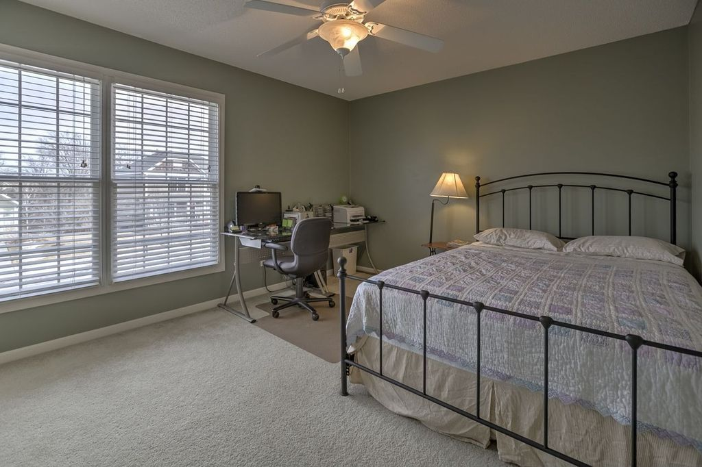 Traditional Guest Bedroom with Standard height, double-hung window, Carpet, Ceiling fan