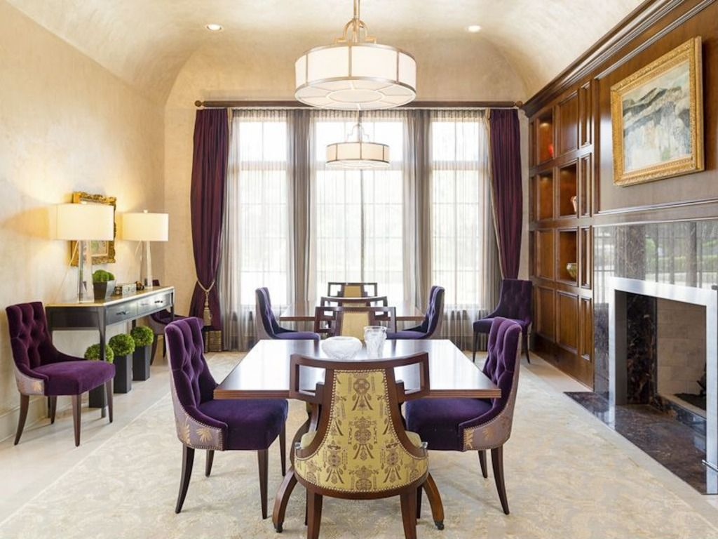 Traditional Dining Room with stone fireplace, Built-in bookshelf, Concrete floors, flush light