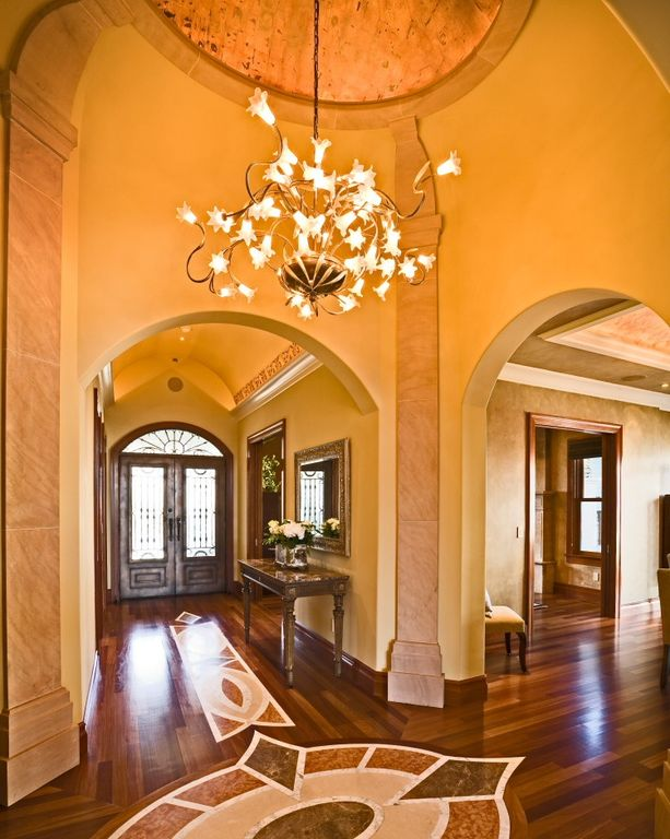 Mediterranean Entryway with Marble floor with patterns, High ceiling, Traditional double front doors, Crown molding, Paint