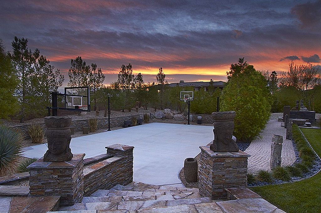 Traditional Landscape/Yard with Fence, exterior stone floors, Bird bath, Fire pit
