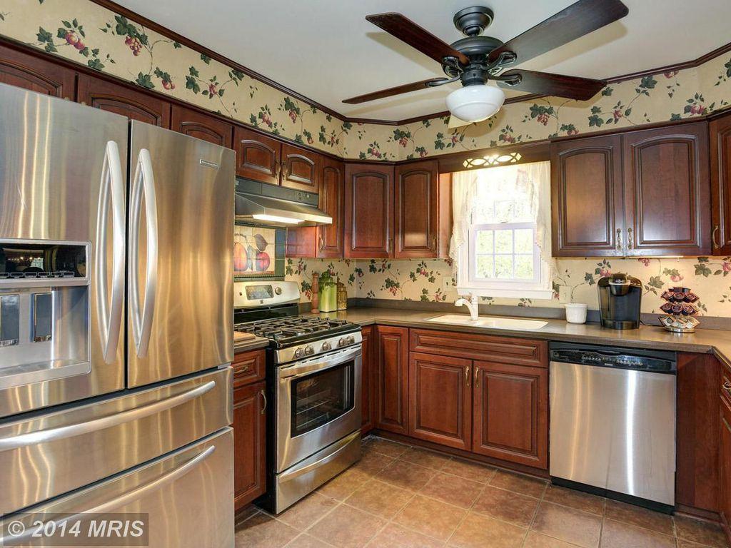 Traditional Kitchen with Wall Hood, Paint, flush light, Multiple Refrigerators, gas range, terracotta tile floors, U-shaped