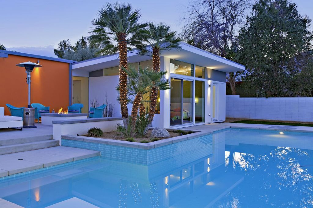 Contemporary Swimming Pool with Transom window, Fire pit, picture window, Other Pool Type, sliding glass door, Fence