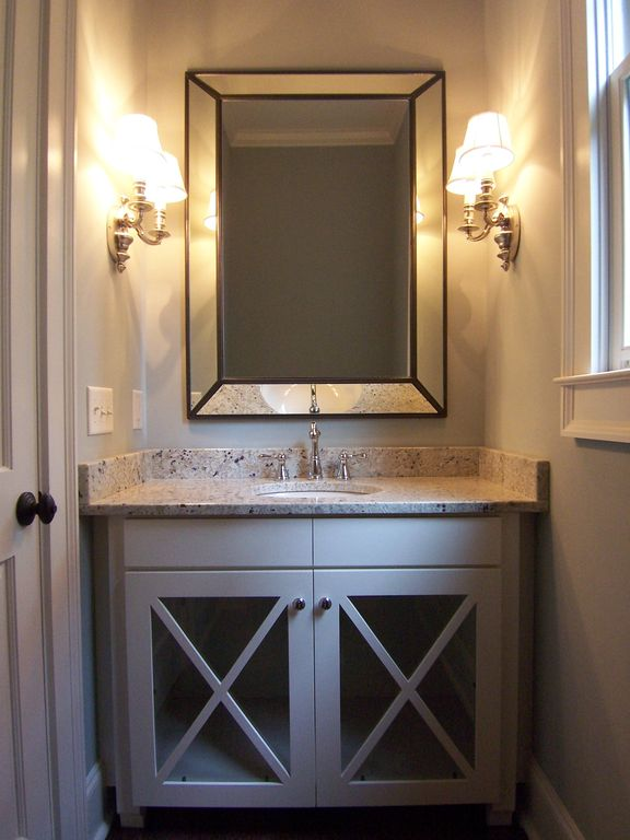 Country Powder Room with Standard height, Glass panel, Flat panel cabinets, Simple Granite, partial backsplash, Wall sconce