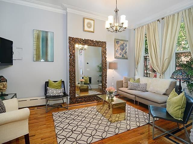 Eclectic Living Room with Standard height, double-hung window, Hardwood floors, Chandelier, Crown molding