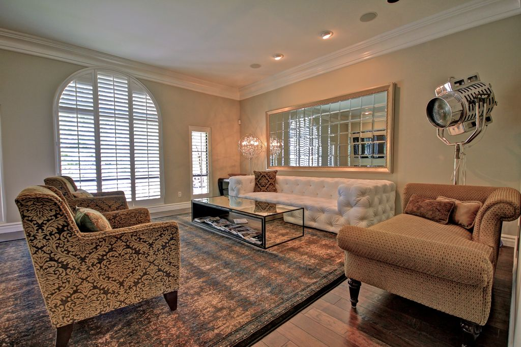 Eclectic Living Room with Standard height, Arched window, picture window, can lights, Hardwood floors, Crown molding