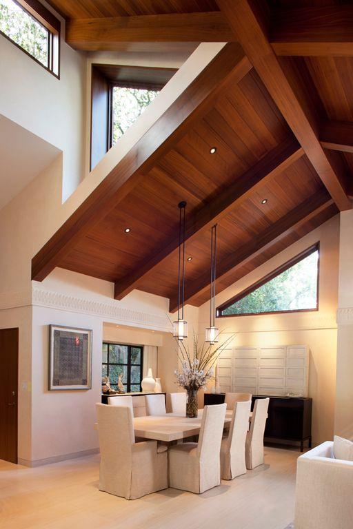 Contemporary Dining Room with Casement, picture window, can lights, Laminate floors, Exposed beam, Pendant light, flat door
