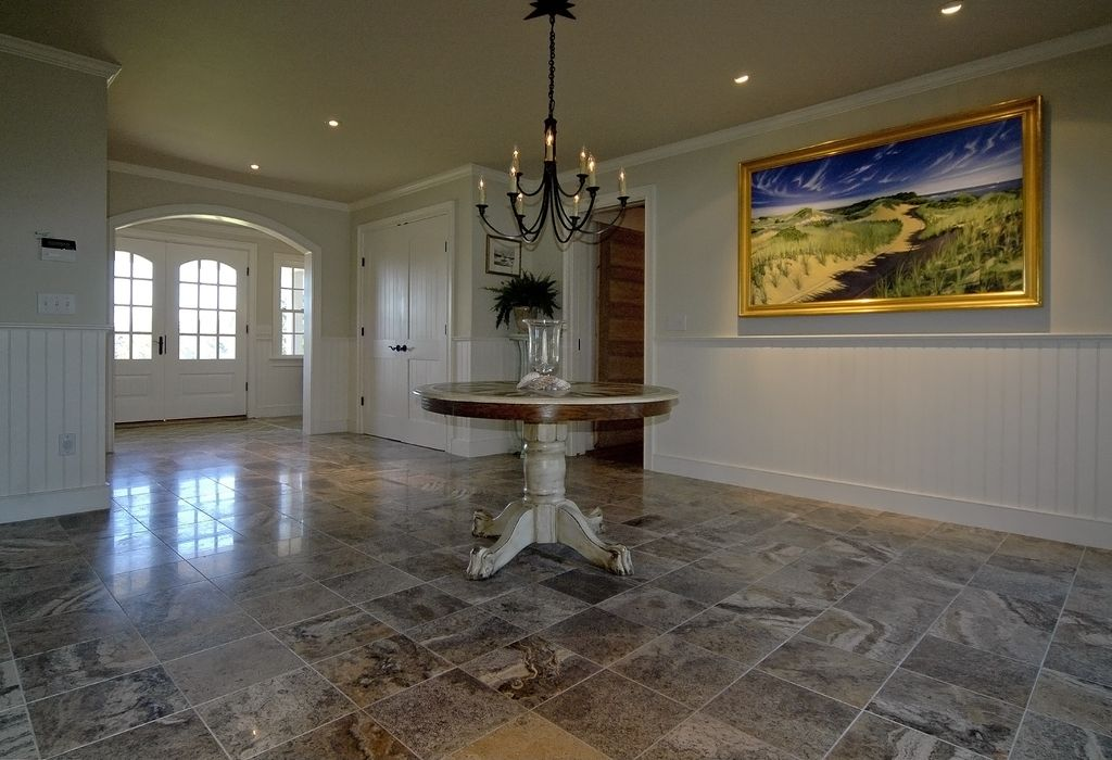 Traditional Entryway with Glass panel door, Chair rail, Standard height, stone tile floors, onyx tile floors, Casement