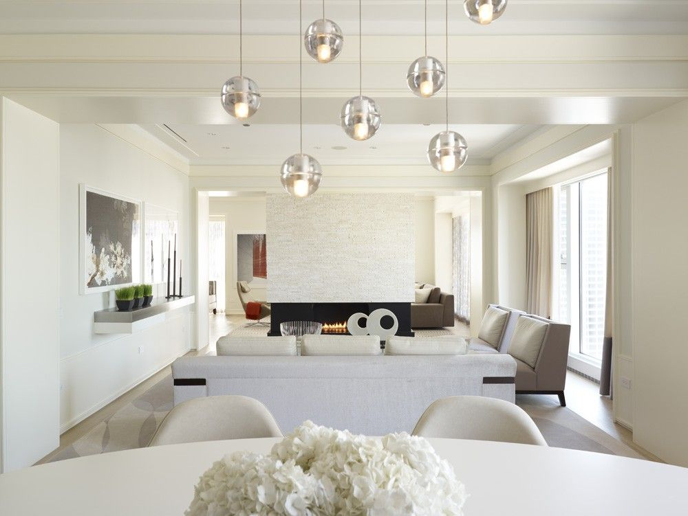 Contemporary Great Room with Crown molding, Standard height, Fireplace, Pendant light, picture window, Laminate floors