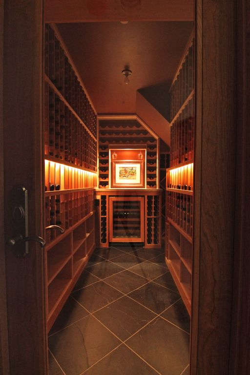 Craftsman Wine Cellar with Crown molding, stone tile floors, French doors, soapstone tile floors, Standard height