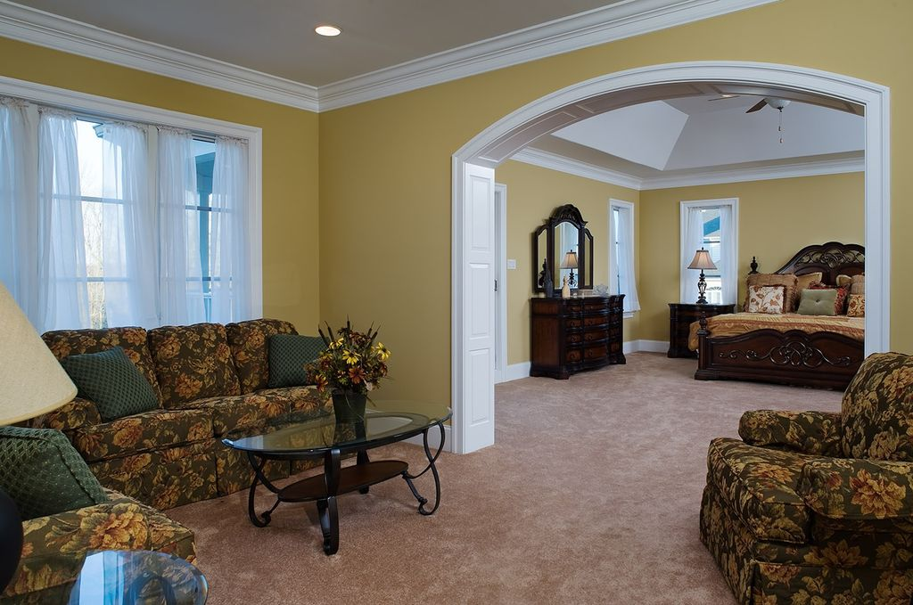 Traditional Master Bedroom with High ceiling, Casement, Ceiling fan, Crown molding, Carpet