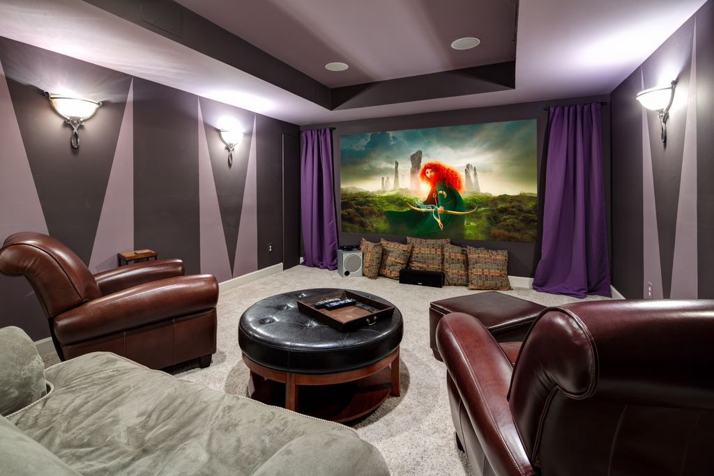 Art Deco Home Theater with High ceiling, Built in surround sound, Wall sconce, Paint 1, Trey ceiling, Carpet, Projector