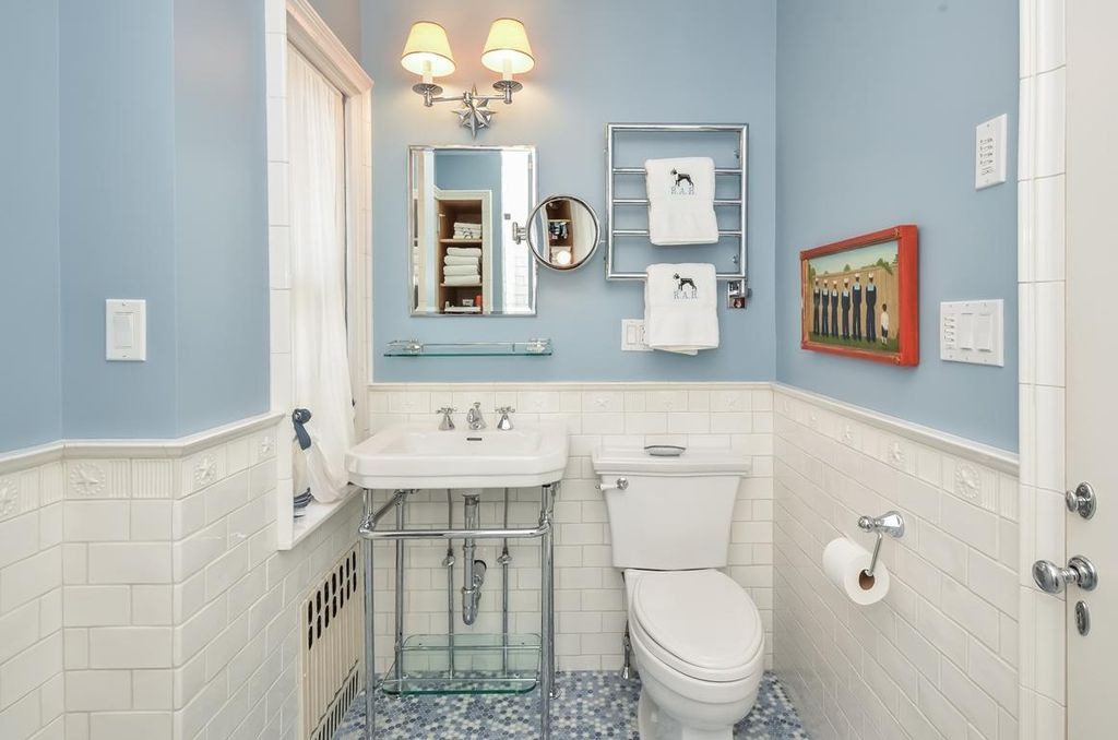 Traditional 3/4 Bathroom with Wall Tiles, Powder room, penny tile floors, Chair rail, flat door, Standard height, Paint 1