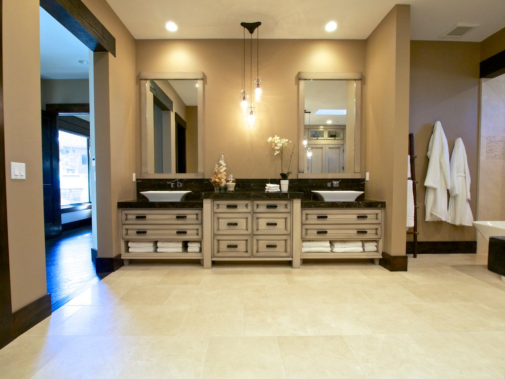 Contemporary Master Bathroom with Pendant light, Complex marble counters, Vessel sink, Double sink, stone tile floors, Flush