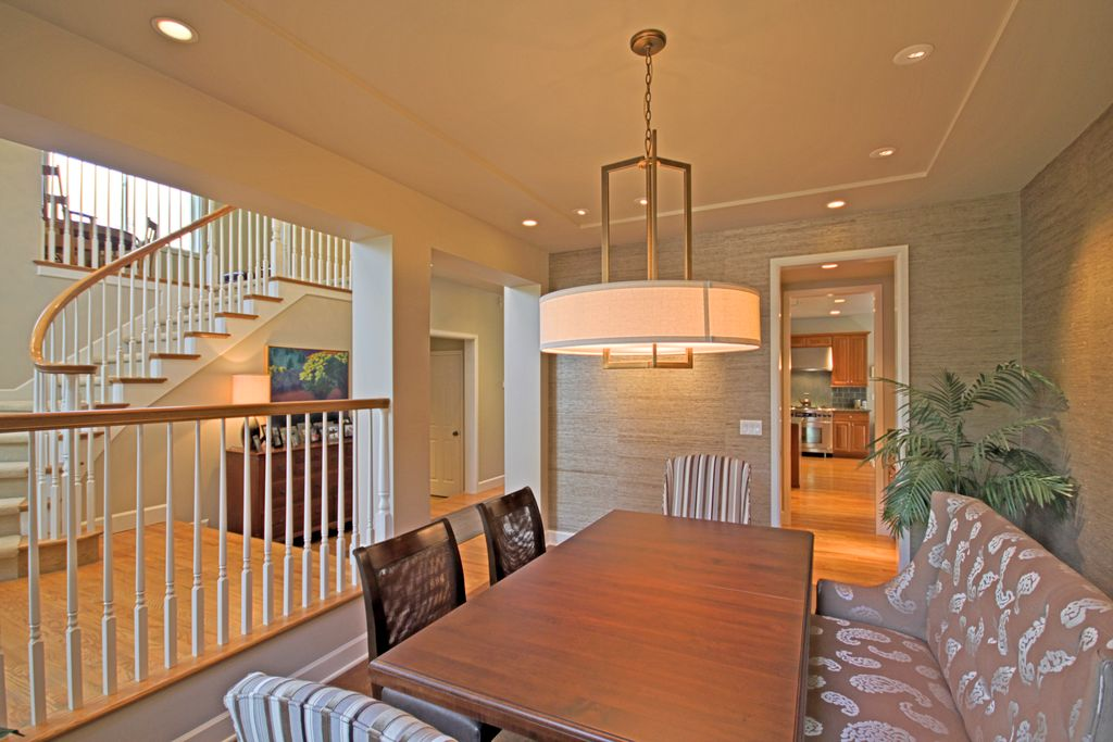 Contemporary Dining Room with Laminate floors, Pendant light, High ceiling