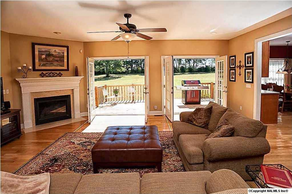 Traditional Living Room with stone fireplace, Ceiling fan, French doors, Standard height, can lights, Hardwood floors