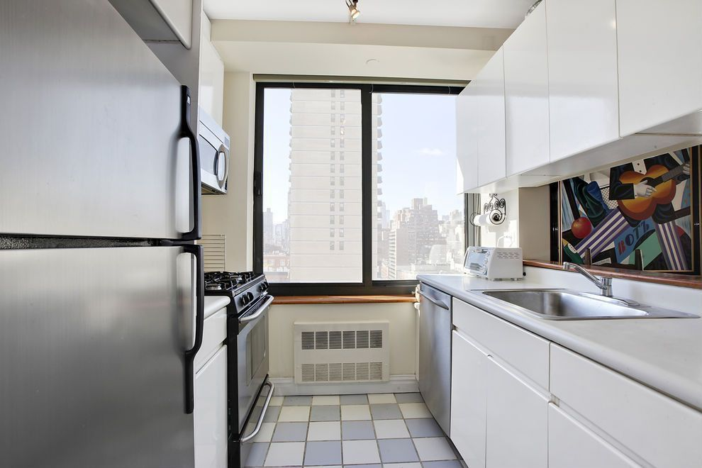 Contemporary Kitchen with Freestanding Full Size Top Freezer Refrigerator, Inset cabinets, dishwasher, flush light, Galley