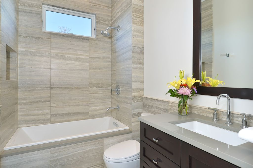 Contemporary Full Bathroom with Flush, tiled wall showerbath, Flat panel cabinets, Quartz counters, Corian pearl grey