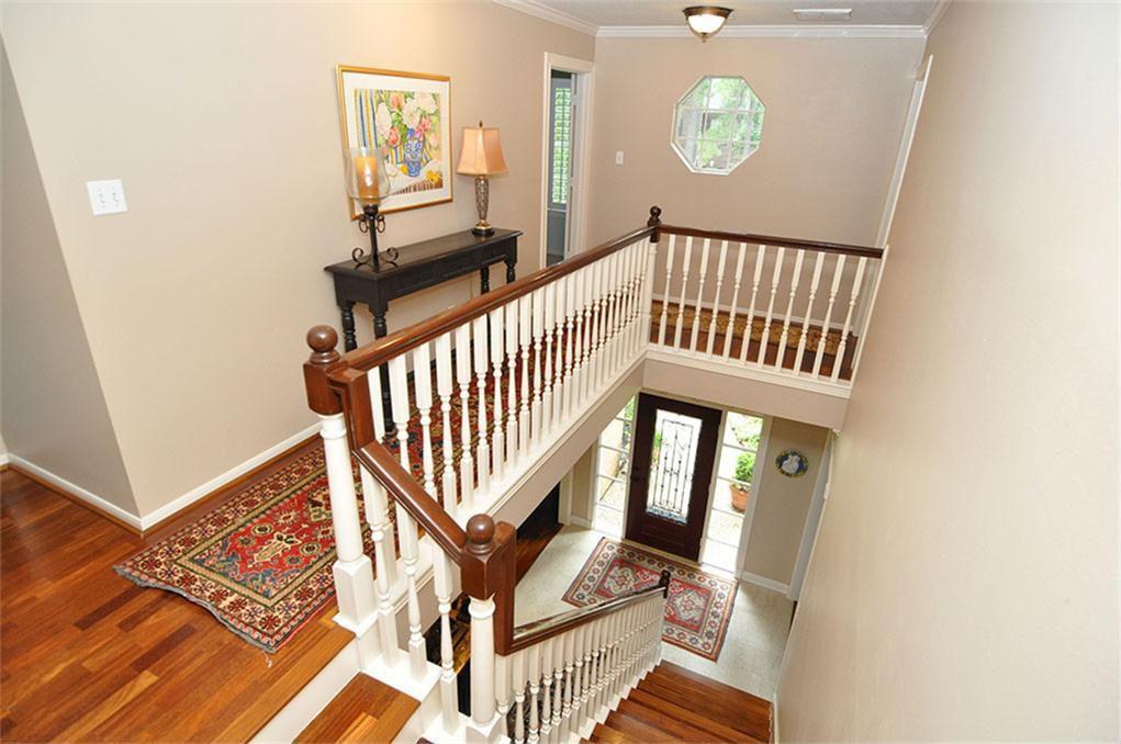 Traditional Hallway with Balcony, flush light, specialty window, Hardwood floors, Crown molding, Standard height
