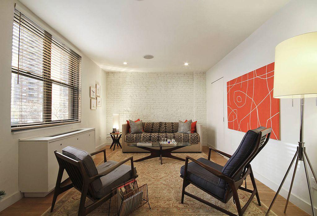 Contemporary Living Room with can lights, interior brick, flat door, Standard height, Hardwood floors, double-hung window