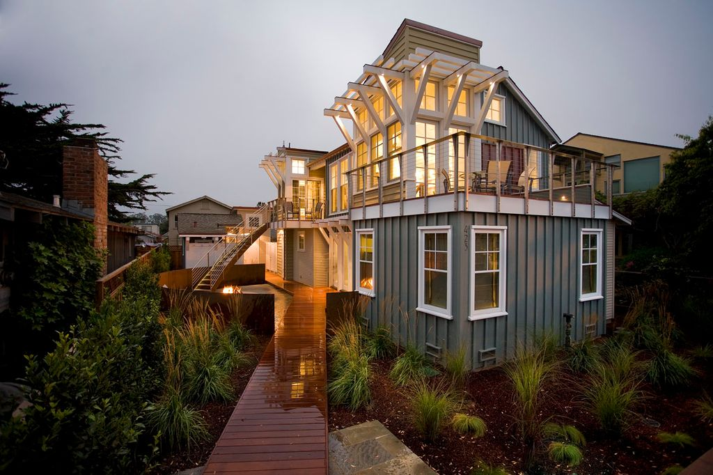 Eclectic Exterior of Home with Paint, Wooden pathway
