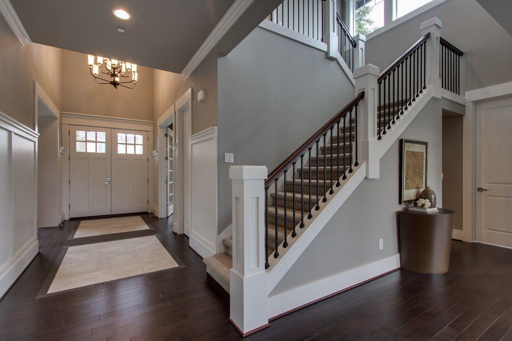 Traditional Staircase with Carpet, High ceiling, curved staircase, picture window, Columns