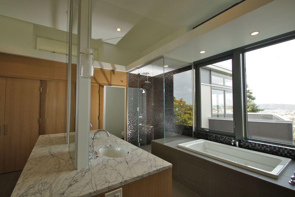 Modern Master Bathroom with Wall Tiles, Casement, drop in bathtub, Undermount sink, Bathtub, stone tile floors, Rain shower