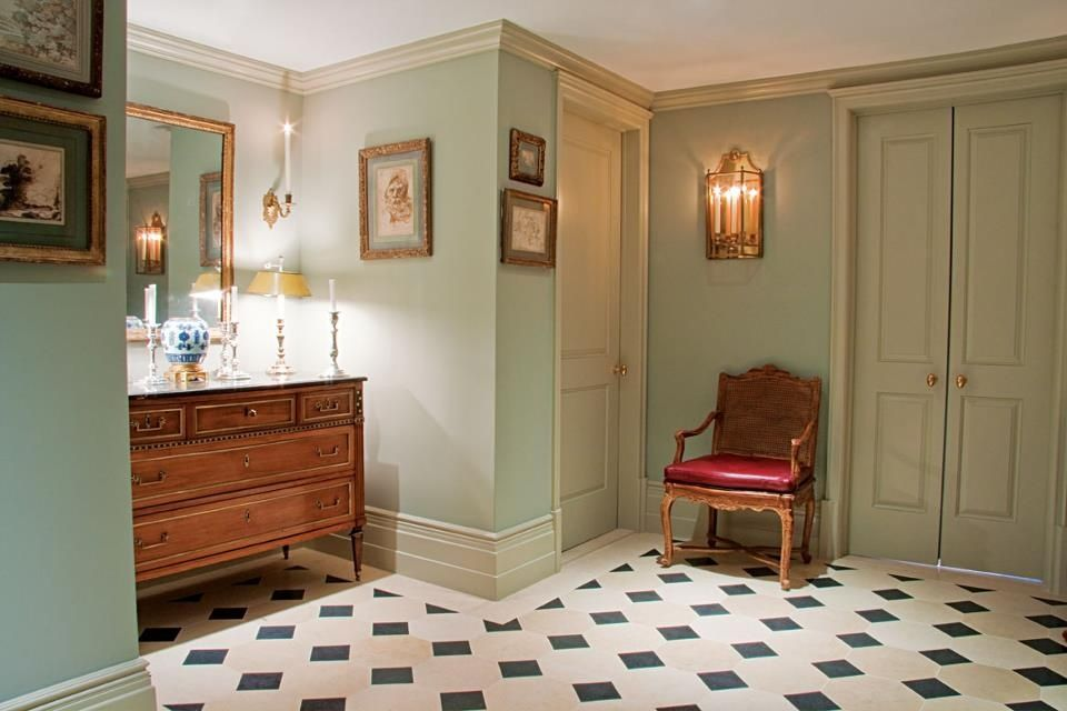 Traditional Hallway with Crown molding, simple marble tile floors, six panel door, stone tile floors, Wall sconce