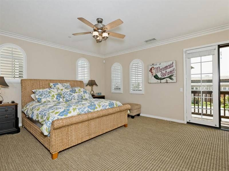 tropical master bedroom with high ceiling ceiling fan in