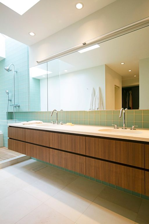 Contemporary Master Bathroom with Standard height, stone tile counters, European Cabinets, Large Ceramic Tile, can lights