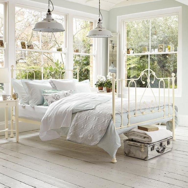 Contemporary Guest Bedroom with Standard height, double-hung window, Pendant light, Hardwood floors