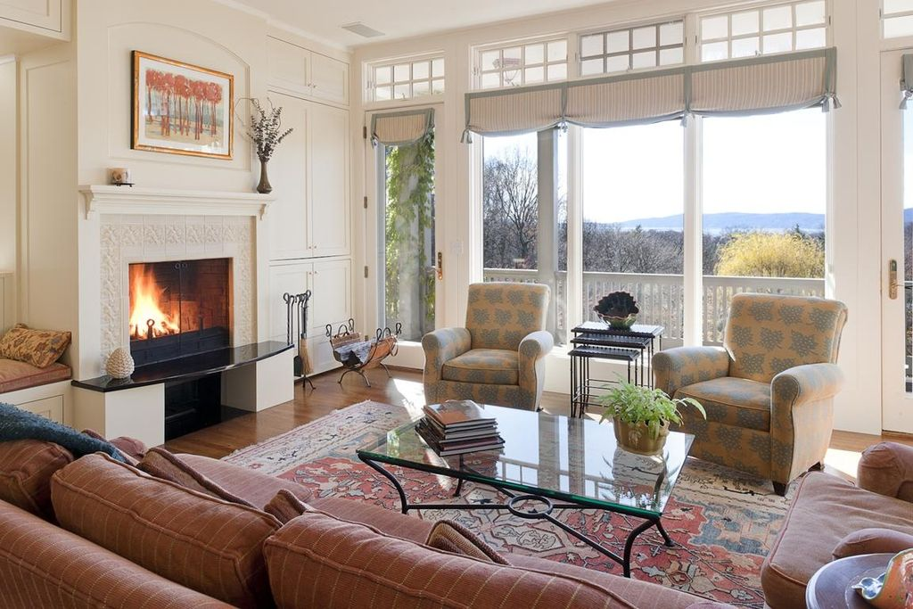 Traditional Living Room with French doors, Fireplace, Standard height, Transom window, stone fireplace, Built-in bookshelf