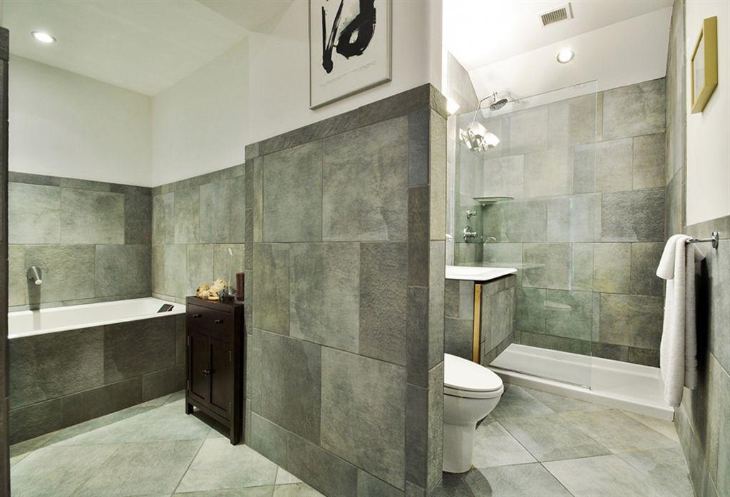 Modern Full Bathroom with stone tile floors, wall-mounted above mirror bathroom light, Rain shower, Wall Tiles, Bathtub