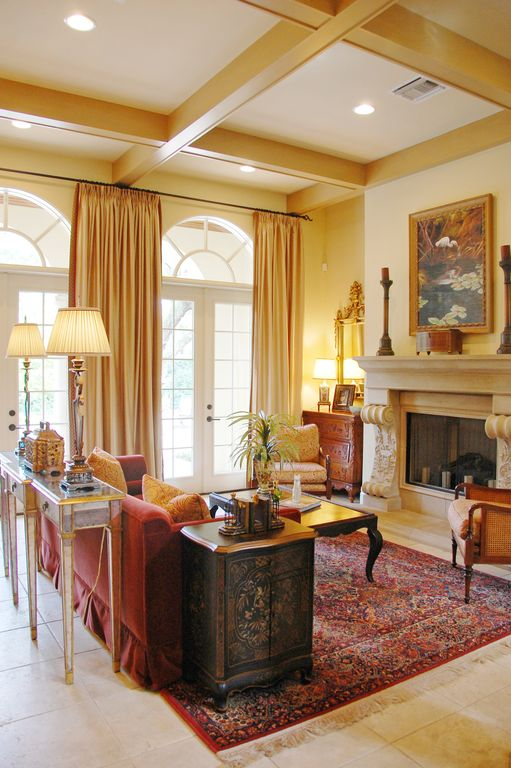 Traditional Living Room with Box ceiling, Arched window, limestone tile floors, French doors, Cement fireplace