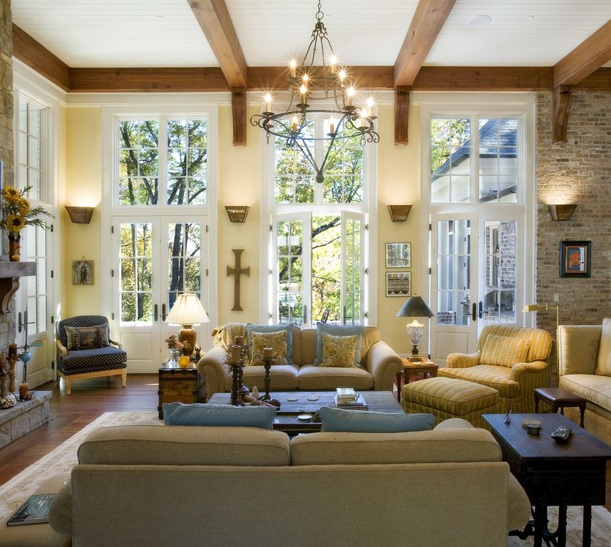 Traditional Living Room with Casement, Paint 1, Laminate floors, Glass panel door, High ceiling, Wood ceiling, Exposed beam