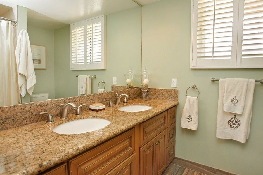 Traditional Full Bathroom with Simple granite counters, Raised panel, Double sink, Flush, Standard height, three quarter bath