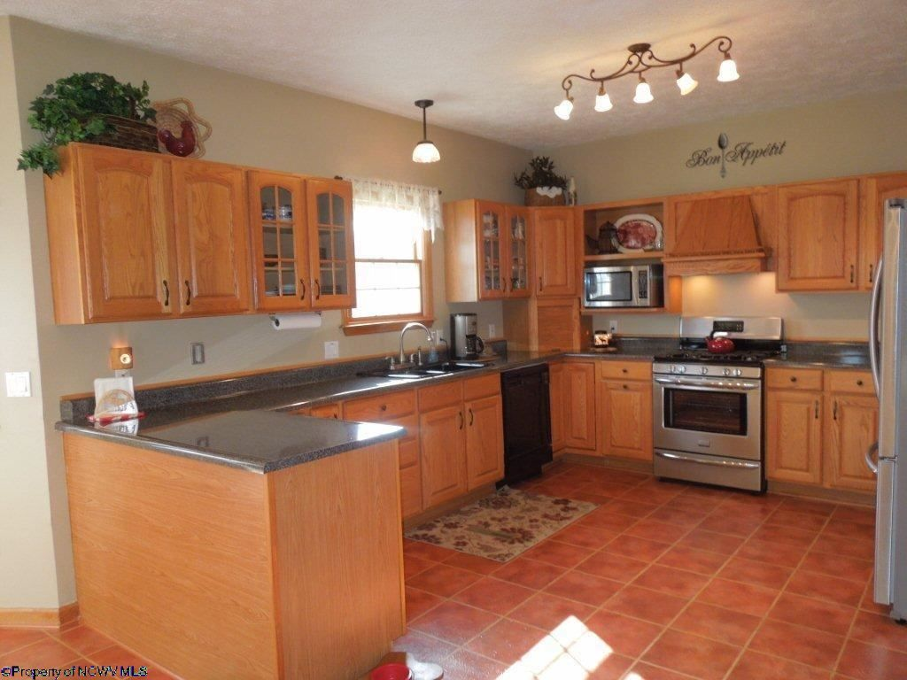 Traditional kitchen with inset cabinets terracotta tile for Terracotta kitchen ideas