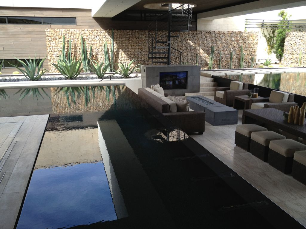 Contemporary Patio with exterior stone floors, Pathway, Infinity pool, Fire pit, picture window