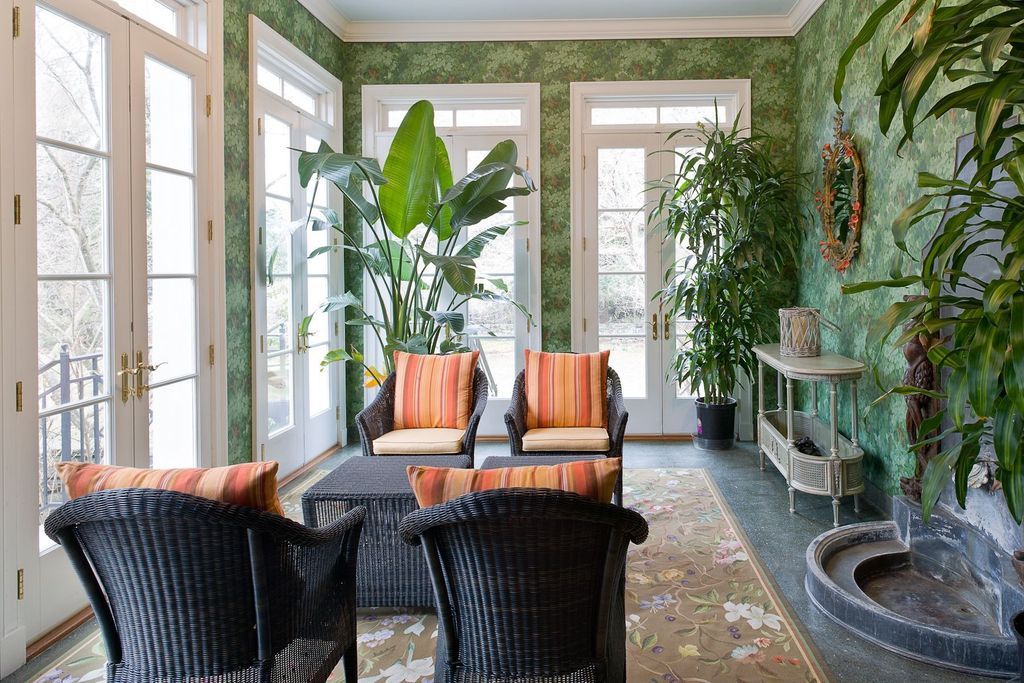 Tropical Porch with interior wallpaper, exterior tile floors, French doors, exterior concrete tile floors, Transom window