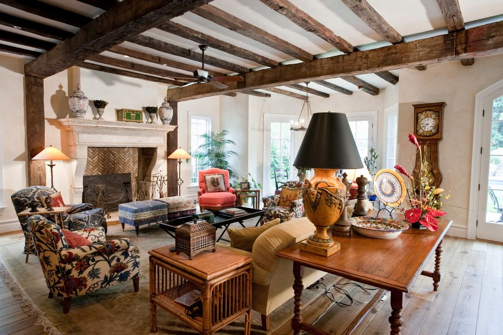 Eclectic Living Room with Exposed beam, can lights, Cement fireplace, Standard height, Fireplace, French doors, Columns