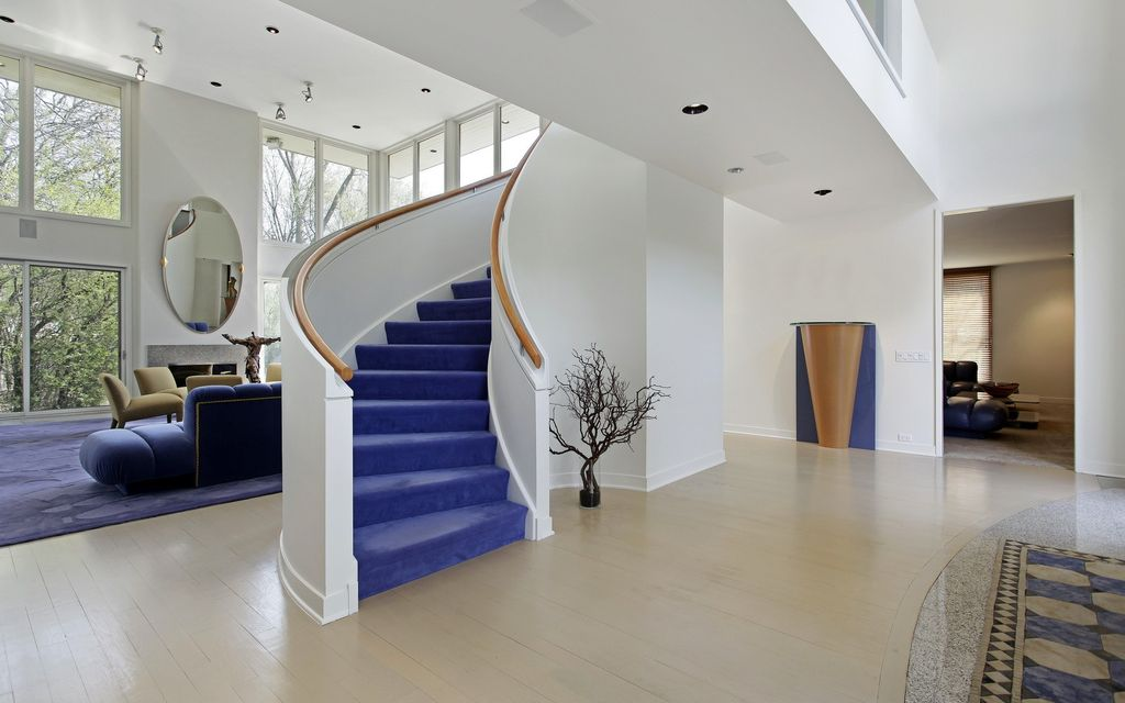 Contemporary Staircase with High ceiling, curved staircase, Carpet