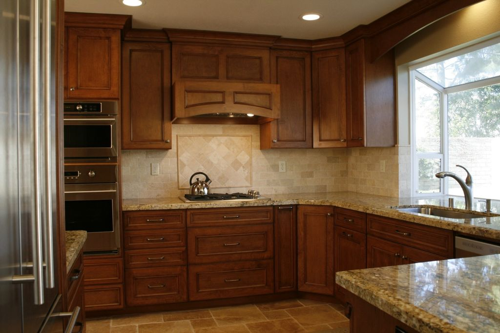 Traditional Kitchen with stone tile floors, can lights, Lapidus, Framed Partial Panel, Stone Tile, Lexington cherry, U-shaped