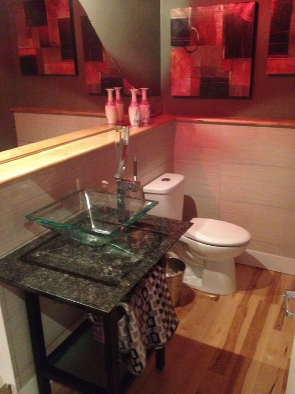 Contemporary Powder Room with Vessel sink, Powder room, Hardwood floors, Standard height, Complex granite counters