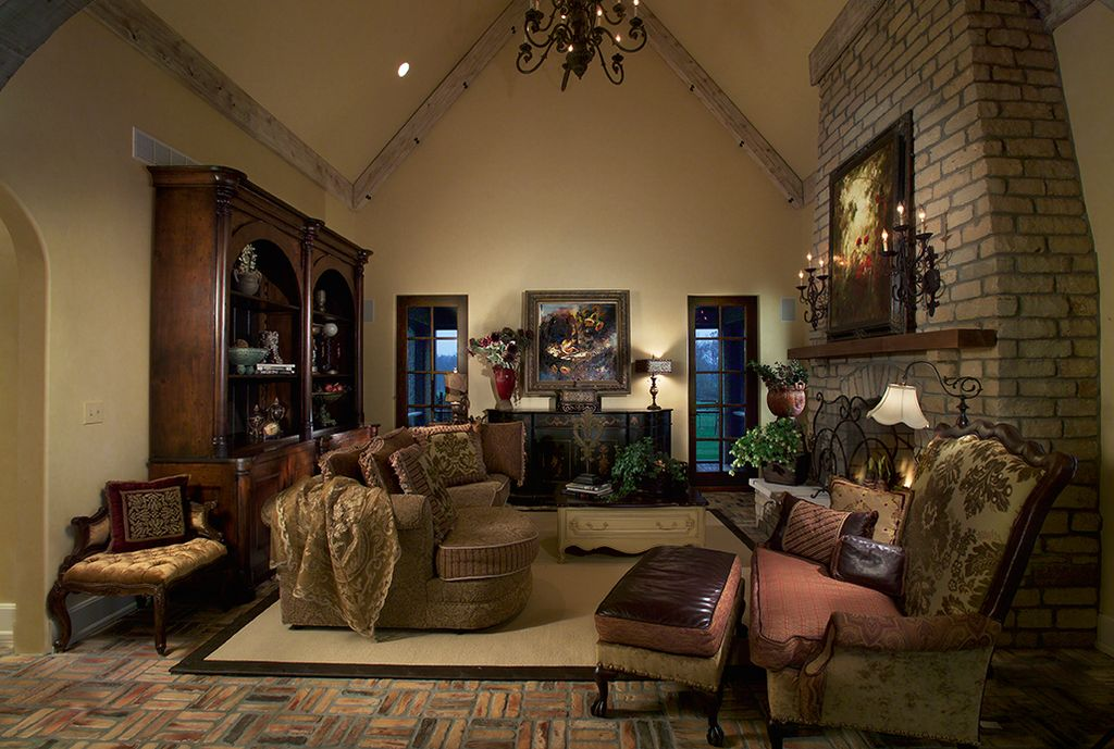 Traditional Living Room with Chandelier, High ceiling, can lights, Fireplace, Crown molding, brick fireplace, Wall sconce