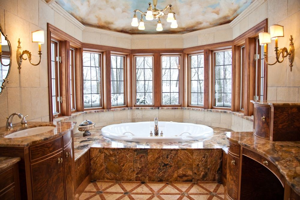 Traditional Master Bathroom with Wall Tiles, Chandelier, European Cabinets, Casement, stone tile floors, Formica counters